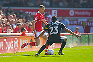 Jordan Williams of Barnsley (22) and Scott Golbourne of Shrewsbury Town (23) in action during the EFL Sky Bet League 1 match between Barnsley and Shrewsbury Town at Oakwell, Barnsley, England on 19 April 2019.