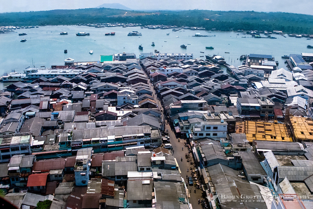 Riau Islands, Bintan. View over Tanjung Pinang. Parts of the city are built on stilts (from helicopter).
