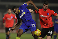 AFC Wimbledon striker Tyrone Barnett (23) and Brighton & Hove Albion defender Tyler Hornby-Forbes (49) battle for possession during the EFL Trophy match between AFC Wimbledon and U23 Brighton and Hove Albion at the Cherry Red Records Stadium, Kingston, England on 6 December 2016. Photo by Stuart Butcher.
