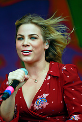 27 April 2014. New Orleans, Louisiana.<br /> Maggie Koerner takes to the stage with Galactic at the New Orleans Jazz and Heritage Festival. <br /> Photo; Charlie Varley/varleypix.com