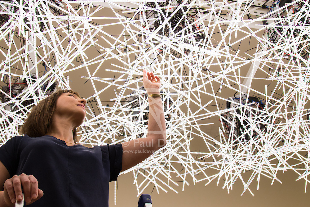 """Somerset House, London, September 21st 2015. Pictured: A woman adjusts """"Transparency; Warm/Wet"""" designed by Melkan Gursel of Tabanlioglu Architects at Somerset House as part of the London Design Festival which runs between September 19th and 27th with a series of artworks and installations created through the collaborations of internationally renowned designers and brands.  // Contact: paul@pauldaveycreative.co.uk Mobile 07966 016 296"""