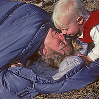 A youngster wakes up his mother during a family camping trip in California's eastern Sierra Nevada.