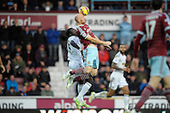 James Collins of West Ham United (r) heads the ball over Bafetimbi Gomis of Swansea City. Barclays Premier league match, West Ham Utd v Swansea city at the Boleyn ground, Upton Park in London on Sunday 7th December 2014.<br /> pic by John Patrick Fletcher, Andrew Orchard sports photography.