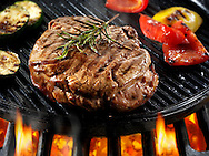 Beef fillet steaks & roast peppers being pan fried on a bbq. Meat food photos, pictures & images.