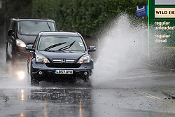 © Licensed to London News Pictures. 23/09/2018. Leatherhead, UK.  Cars splash through partially flooded roads in Leatherhead, Surrey - as heavy rain hits parts of the south. Warmer temperatures are expected in a few days.  Photo credit: Peter Macdiarmid/LNP