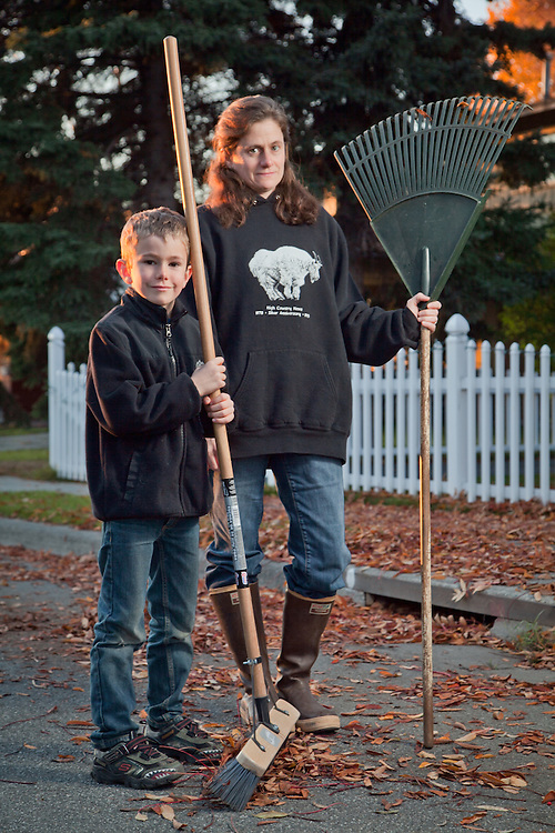 Eleven year old, Eliot Pearce, rakes leaves with his mother, Elizabeth Manning, at the home of Niel Thomas and Hermain Baker, near Westchester Lagoon, Anchorage