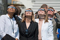 Unidentified White House staffers look skyward at the at the partial eclipse of the sun from the South Lawn of the White House in Washington, DC, USA, on Monday, August 21, 2017. Photo by Ron Sachs/CNP/ABACAPRESS.COM