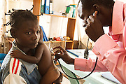 A health worker examines a sick child in a clinic run by MSF next to the Tabacongo health center, in the town of Tabacongo, Katanga province, on Sunday February 19, 2012.