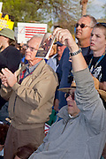 """Apr. 15, 2009 -- PHOENIX, AZ: A man holds up a copy of the US Constitution during the """"Tea Party"""" at the Arizona State Capitol in Phoenix Wednesday. Nearly 10,000 people attended the rally, which was supposed to be in opposition to the Obama economic plan but turned into a general anti-Obama rally.  Photo by Jack Kurtz"""
