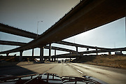 "Pass-overs highways. Arriving in Los Angeles...Images to illustrate the road and the people you meet along the way on a trip across the USA...A 4-weeks road trip across the USA, from New York to San Francisco, on the steps of Jack Kerouac's famous book ""On the Road"".  Focusing on nomadic America: people that live on the move across the US, out of ideology or for work reasons."