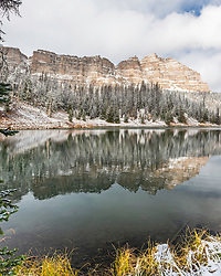A hint of winter at Wind River Lake in the Absaroka Range of western Wyoming.  The mountain is Breccia Peak