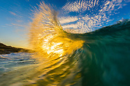 """Buy a print of """"Sunburst"""" today to brighten any home or office!<br /> <br /> I slowed my shutter speed and captured this motion effect of the wave as it was backlit by the setting sun."""