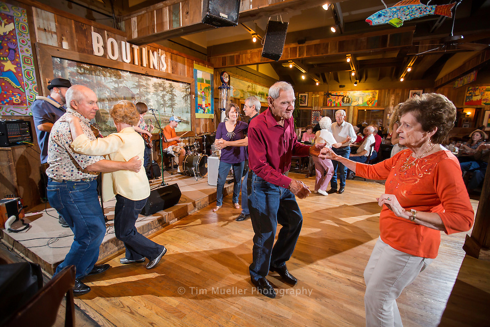 From left, Ken and Rose Roberts, Roy Guidry (red shirt) and Beverly LeBlanc dance as Lee Benoit and his Cajun band perform Saturday night at Boutin's in Baton Rouge, La.
