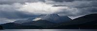 Ben Nevis, Britain's highest mountain, with cloud covered summit rises above Loch Linnhe, Lochaber, Scotland