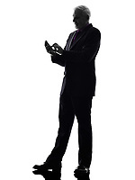 One Caucasian Senior Business Man on the telephone text messaging Silhouette White Background