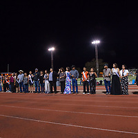 Gallup High School students and family members walk out for the announcement of the Homecoming King and Queen at halftime on Friday Sept. 21st at Angelo Dipaolo Stadium in Gallup.