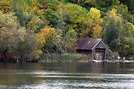 An aging boathouse along the Rideau River in Ottawa, Ontario, Canada.  Photographed from the Black Rapids Dam.
