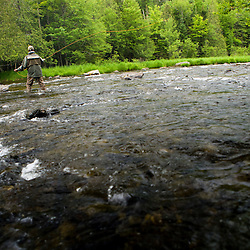 Fly fishing on the Connecticut River in Pittsburg, New Hampshire.  Just below the dam at First Connecticut Lake.