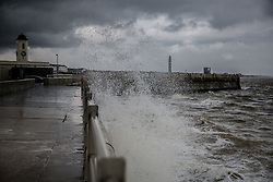 @Licensed to London News Pictures 05/11/2014. Margate, Kent, UK. Strong northerly winds with gusts of up to 25mph hit the Thanet coast on Margate seafront tonight. Photo credit: Manu Palomeque/LNP