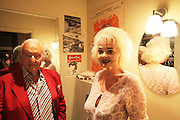 Wolf C Hartwig aged 91, producer of epic films and soft-porn features, with his fourth wife, and actress, Veronique Vendell in their apartment on Avenue de Foch, Paris. Wolf Hartwig was awarded a Bambi Award from German Cinema for his film 'The Iron Cross' which was directed by Sam Peckinpah starring James Coburn with Veronique Vendell. A producer working in exploitation genres, soft porn, sex, lurid, violent and sensational features. Other films he produced include 'Horrors from Spider Island'. 'Lady Hamilton' and 'Virgin of the Seven Seas'.// Wolf Hartwig and Veronique Vendell in their toilet, the poster behind 'Sleeping with my assasin