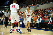 DALLAS, TX - JANUARY 21: Nic Moore #11 of the SMU Mustangs brings the ball up court against the Rutgers Scarlet Knights on January 21, 2014 at Moody Coliseum in Dallas, Texas.  (Photo by Cooper Neill/Getty Images) *** Local Caption *** Nic Moore
