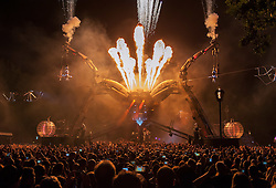"""© Licensed to London News Pictures. 05/09/2015. Bristol, UK.  Arcadia's Metamorphosis show in Bristol's historic Queen Square, as the city hosted the world's first recycled biofuel pyrotechnics show. The 50-tonne Arcadia spider, made from used repurposed military hardware and fuelled by waste oil from local fish and chip shops, landed in the city this weekend to celebrate its year as European Green Capital 2015. Arcadia's founders, Pip Rush and Bert Cole explain; """"We're hugely honoured to play a part in Bristol's year as Green Capital and have been overwhelmed by the excitement around the city. We're proud to be a part of Bristol's vibrant community and hope that by performing a new show amidst a dynamic mechanical sculpture that is built and powered by re-used resources, we can share a weekend of collective joy with thousands in the heart of the city."""" Zoe Sear, Bristol 2015, added: """"We are excited that Bristol will host the world's first pyrotechnics show fuelled entirely by recycled biofuel – this is a seminal moment for the city. The iconic spider is not only made from 'waste' materials, but now its flames will be powered by waste oil collected from Bristol's chip shops, which is a brilliant example of how our resources can be re-used. With the theme of the Metamorphosis show focused on transformation and change, it is bringing the ethos of sustainability to life."""" Metamorphosis, which was unveiled at Glastonbury Festival in June, took place in Bristol on 4 and 5 September. The show - Arcadia's first ever inner city event – saw the spider come alive as a living organism, fusing sustainable ideas and technologies with art, music and performance, to create a spectacular symphony of transformation. It was part-funded by Arts Council England under its Exceptional Awards Scheme as part of Bristol's year in the spotlight as the UK's first European Green Capital. Photo credit: Simon Chapman/LNP"""