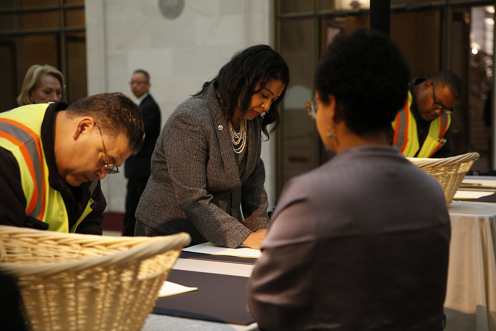 Acting Mayor London Breed signs the guest book as San Francisco Mayor Ed Lee lies in state at City Hall on Friday, Dec. 15, 2017, in San Francisco, Calif. Lee died on Tuesday from a heart attack. He was 65 years old.