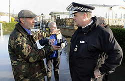 © Licensed to London News Pictures. 06/01/2014<br /> The NEW Kent Police Chief Constable Alan Pughsley at  Little Venice,Yalding.<br /> Yalding village Flood water starts receding again as a clear up operation starts.<br /> The village in Kent also gets a visit from the new Kent Police Chief Constable Alan Pughsley and Kent Police Commissioner Ann Barnes who walked around Little Venice Country Park meeting residents.  Alan Pughsley has been in the post since January 4th 2014.<br /> Photo credit :Grant Falvey/LNP
