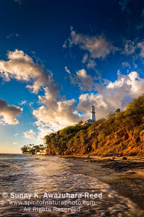 Diamond Head Lighthouse and Diamond Head Beach Park under afternoon light. Honolulu, Oahu Island, Hawaii.