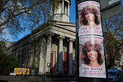 London, UK. 5th May, 2021. Posters outside St Pancras Church call on members of the public to vote for Burning Pink candidate Valerie Brown on the eve of the London Mayoral election. Burning Pink is a radical political party campaigning for rapid action to combat the climate emergency through the setting up of citizens assemblies.
