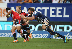 Elton Jantjies of the Lions is tackled by Andries Bekker during the Super Rugby (Super 15) fixture between the DHL Stormers and the Lions held at DHL Newlands Stadium in Cape Town, South Africa on 26 February 2011. Photo by Jacques Rossouw/SPORTZPICS