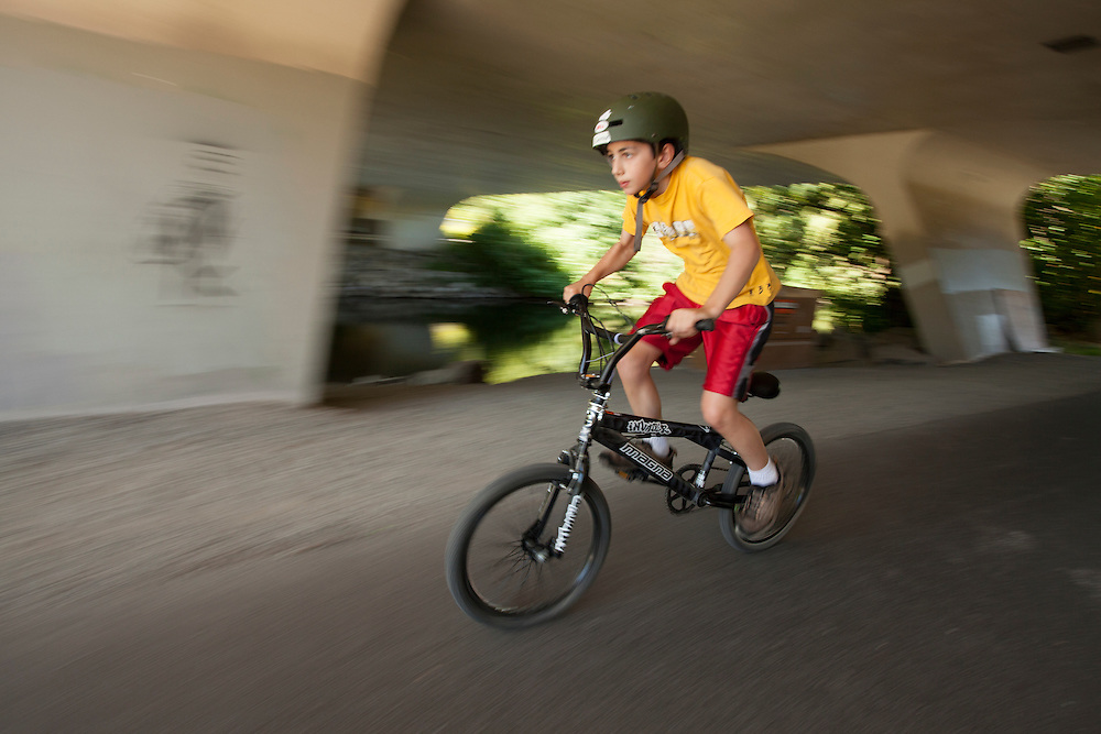 United States, Washington, Redmond, boy on bicycle on Sammamish River Ttrail  (blurred motion)  MR