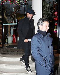 Manchester City manager Pep Guardiola leaves San Carlo Italian Restaurant in Manchester city centre at about 11.15pm on Sunday night after having dinner with friends