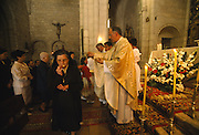 Worhisppers receive the consecrated bread known as the Eucharist, at the celebration of mass during the Fiesta del Colaco, in Castrillo de Murcia, Burgos province, Spain. The Fiesta del Colacho is held every year at the time of the Catholic feast Corpus Christi.