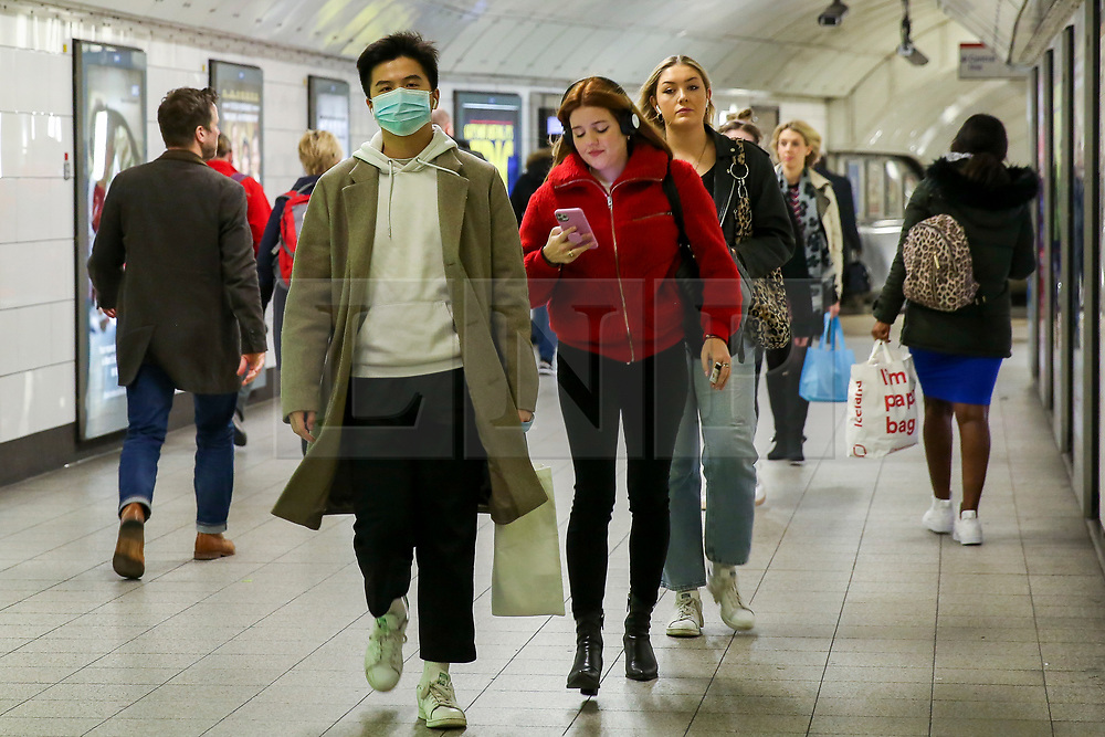 © Licensed to London News Pictures. 11/03/2020. London, UK. A commuter with a surgical face mask at Oxford Street station amid an increased number of cases of Coronavirus (COVID-19) in the UK. Chancellor RISHI SUNAK has unveiled a £30bn package to help the economy get through the coronavirus outbreak in the UK. Photo credit: Dinendra Haria/LNP