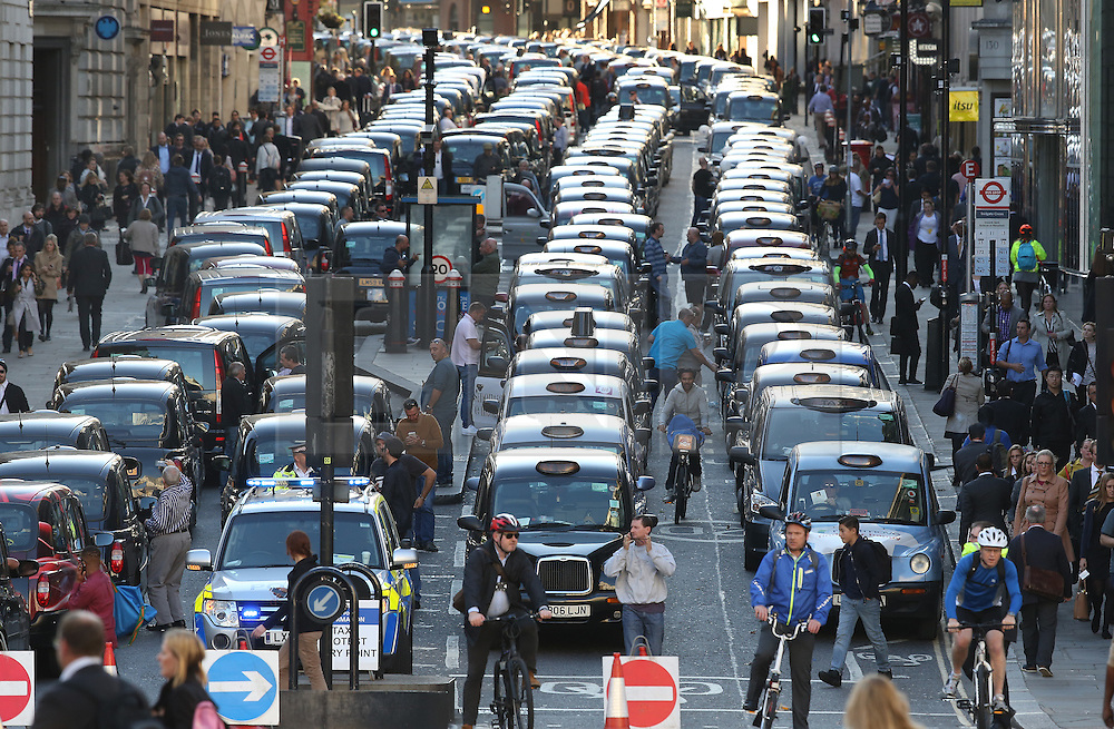 © Licensed to London News Pictures. 30/09/2015. London, UK. Black cabs block Fleet Street in protest over the Uber taxi app. Photo credit: Peter Macdiarmid/LNP