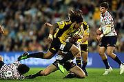 Ma'a Nonu in mid air beats Luke Burgess<br /> Super 14 rugby union match, Waratahs vs Hurricanes, Sydney, Australia. <br /> Saturday 14 May 2010. Photo: Paul Seiser/PHOTOSPORT
