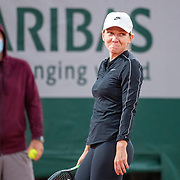 PARIS, FRANCE September 25. Simona Halep of Romania reacts while training on Court Philippe-Chatrier in preparation for the 2020 French Open Tennis Tournament at Roland Garros on September 25th 2020 in Paris, France. (Photo by Tim Clayton/Corbis via Getty Images)