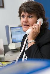 School Estate Coordinator talking on the telephone,