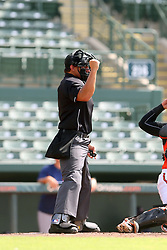 July 17, 2018 - Sarasota, FL, U.S. - Sarasota, FL - JUL 17: Home plate umpire Mickey Smith  calls a strike during the Gulf Coast League (GCL) game between the GCL Twins and the GCL Orioles on July 17, 2018, at Ed Smith Stadium in Sarasota, FL. (Photo by Cliff Welch/Icon Sportswire) (Credit Image: © Cliff Welch/Icon SMI via ZUMA Press)