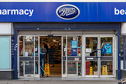 © Licensed to London News Pictures. 04/02/2020. London, UK. Boots chemists in Streatham High Road reopens with what appears to be 3 bullet holes masked by cardboard at the front of the shop where a knife-wielding terror suspect in a suicide vest was shot dead by undercover police on Sunday 01 February 2020 after stabbing two people in the street. Ministers are trying to bring in legislation to stop extremists being freed early from prison unless agreed by a Parole Board. Photo credit: Alex Lentati/LNP