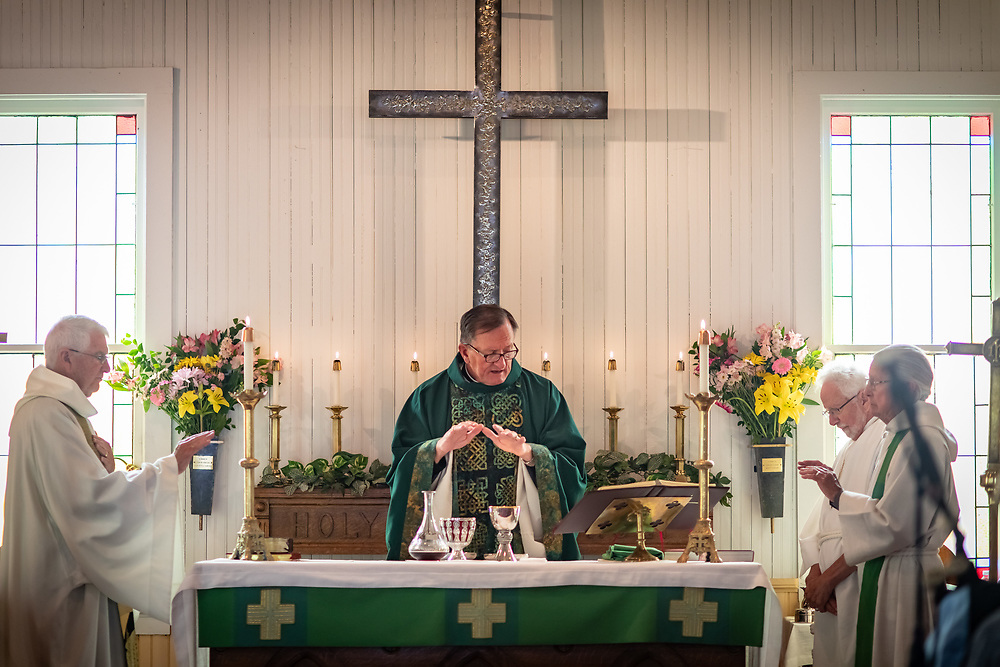 Parishioners, family and friends celebrate Holy Communion with a Scottish theme as Father Rich Munsell officiates the morning after his surprise party.