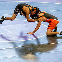 Gallup Bengal Rico Browning shoots against Aztec Tiger Caleb Varzeas during the district Wrestling meet at Miyamura High School in Gallup Saturday.