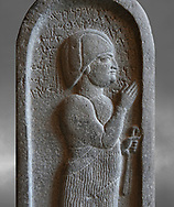Neo Hittite basalt funerary stele from Neirab or Tell Afis, Syria, 7th cent BC. Louvre Museum. Grey background