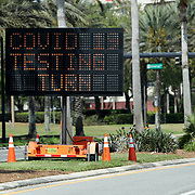 A digital street sign instructs residents where to turn for Coronavirus (COVID-19) testing at the Orange County Convention Center on Friday, March 27, 2020 in Orlando, Florida. (Alex Menendez via AP)
