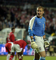 Photo. Jed Wee.<br /> Poland v England, World Cup Qualifier, Stadion Slaski, 08/09/2004.<br /> England's new goalkeeper Paul Robinson (R) is powerless to stop the Polish equaliser<br /> <br /> NORWAY ONLY