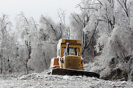 Greenville, NY - A bulldozer at an old construction site and trees are covered in ice after an ice storm on Dec. 14, 2008.