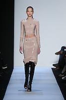Bruna Tenorio walks the runway wearing Hervé Leger Fall 2014 in New York on February 7th, 2014