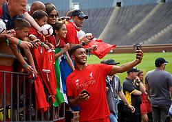 ANN ARBOR, USA - Friday, July 27, 2018: Liverpool's Joe Gomez takes a selfie with a supporter's iPhone after a training session ahead of the preseason International Champions Cup match between Manchester United FC and Liverpool FC at the Michigan Stadium. (Pic by David Rawcliffe/Propaganda)
