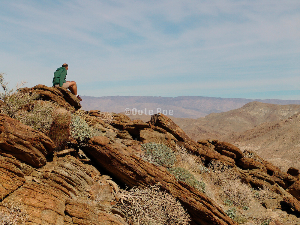 Person on top of a mountain enjoying the view.